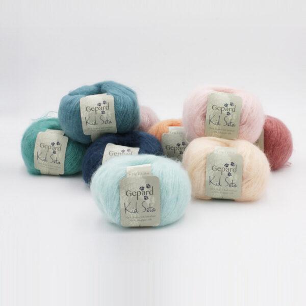 Présentation de plusieurs pelotes de Kid Seta de Gepard Garn dans des coloris assortis